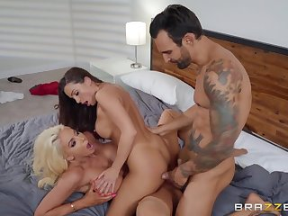 Two sluts with sexy fake tits share a dick