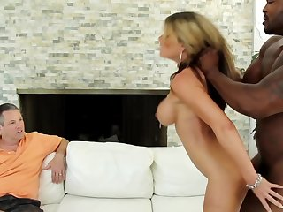 A blonde is getting fucked in front of her cuckold husband hard