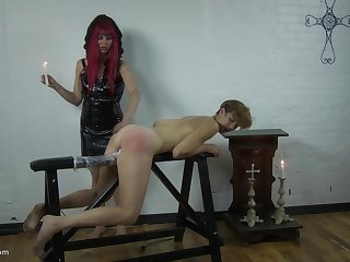Redhead mistress makes a skinny girl moan by spanking her ass