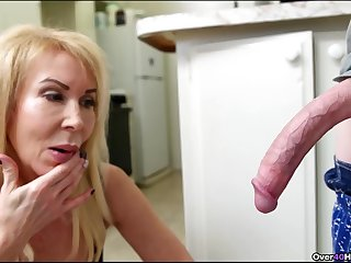 Skinny guy with a long dick gets a handjob in the kitchen from Erica