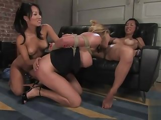 Two hot asian chicks dominate a blonde beauty,