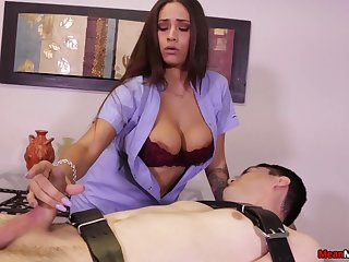 Jamie Valentine titillates a bound massage client with her tits and hands