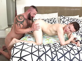 Muscular bull ass fucks twink and cums on his face