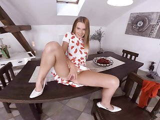 Sex-hungry blonde Timea Bella is toying pussy on the table