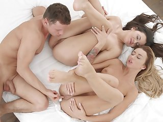 Lucky dude stings both these cute girls in superb threesome